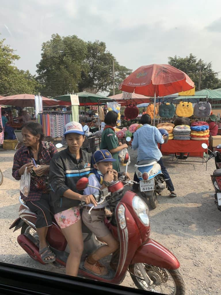 mom, grandma and school boy ride a scooter