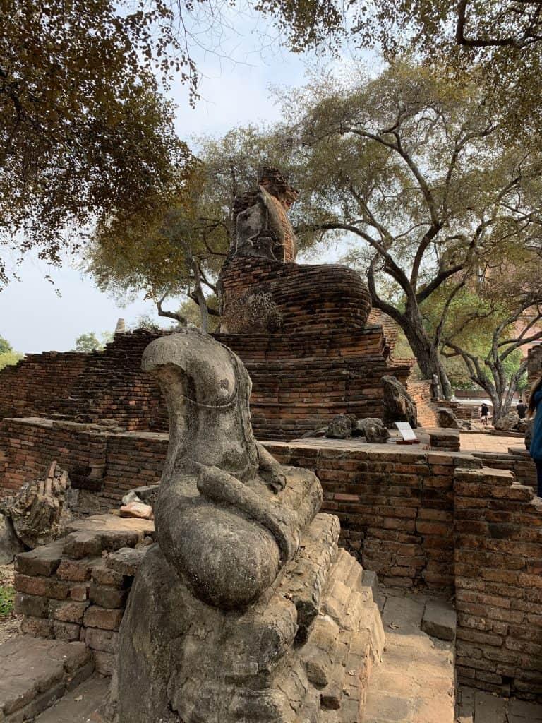 headless sitting buddha ruins