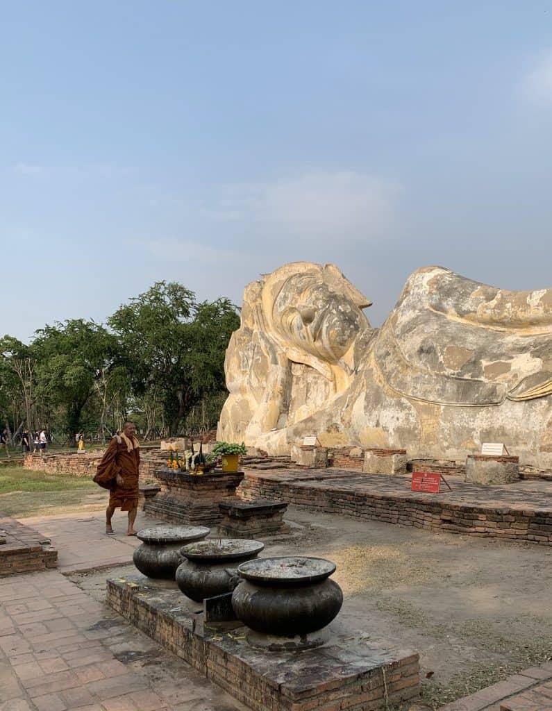 Monk paying respects at Wat Lokaya Sutha