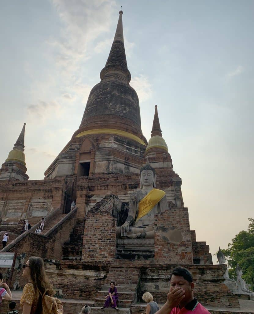 large chedi with Buddha image in front