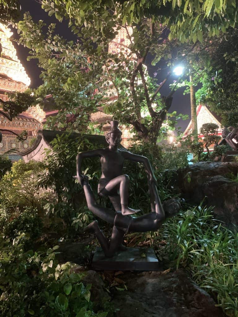 The statues of naked hermits are posed in the different positions of healing massage